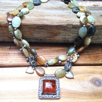 Baltic Amber and jade necklace sterling silver Amber pendant with silver plated accents.