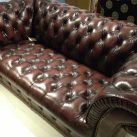 Handmade couch made of oak and real leather.