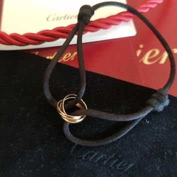 AUTHENTIC CARTIER TRINITY DE CARTIER BRACELET 18K GOLD CHARITY BLACK SILK CORD