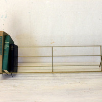 mid century wire book rack // gold tone metal book shelf