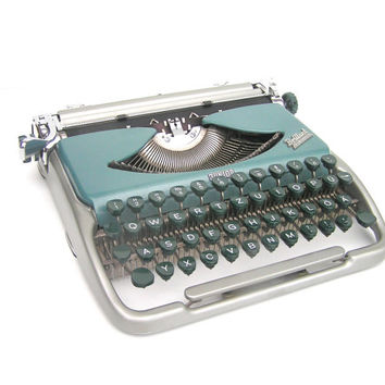 Typewriter Neckermann Brillant very good working condition teal blue industrial lightweight portable home office decor