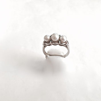 Three Faux White Pearls in Sterling Silver Setting with four small Aquamarines and Blossom and Leaf Detail - Approximate Size 10