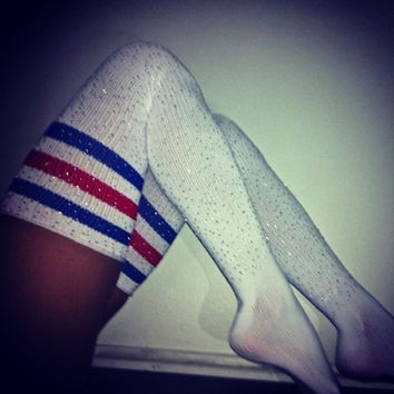 crystallized athletic thigh high socks with red + blue stripes.