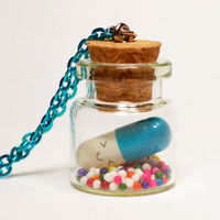 Kawaii Blue Happy Pill Necklace - Miniature Bottle Necklace with Rainbow Sprinkles and happy face pill capsule