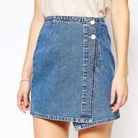 ASOS Denim Pelmet Mini Skirt With Wrap Front In Stone Wash at asos.com