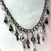 crystal gunmetal bling necklace with key and mirror charms and rhinestones