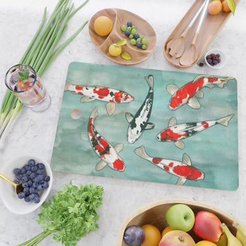 Le ballet des carpes koi Cutting Board by savousepate