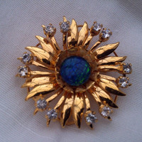 Rhinestone and faux opal gold tone flower brooch / pin. Ideal gift.