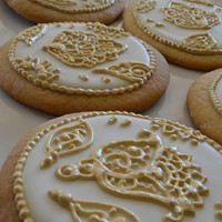 White and Gold Cookies decorated with Hindu designs