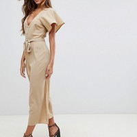 ASOS DESIGN tea jumpsuit with button front and tie detail at asos.com