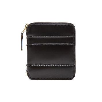 Comme Des Garcons Raised Spike Zip Fold Wallet in Black | FWRD