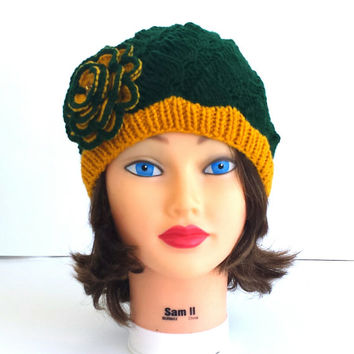 "Knit hat decorated with big flower for true fan of ""Packers"" football team."