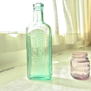 pair antique bottles / pair of vintage bottles / antique glass 1920s purple lilac teal green dr wb caldwell syrup pepsin vaseline