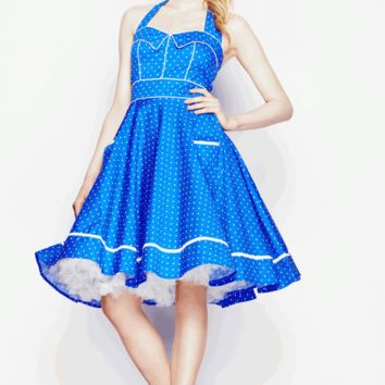 Get your retro look in this Whimsical Vanda 50's Pinup Dress! This vintage inspired 50's pinup dress features blue back ground against white polka dot print throughout, sweetheart neckline with collar detail, adjustable self fabric halter straps, white pip