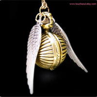 a harry potter Enchanted Steampunk Golden snitch by touchsoul