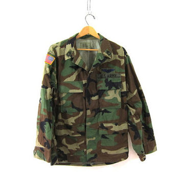 Vintage men's army shirt. military jacket. camouflage coat with patches