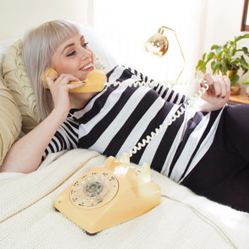 vintage yellow rotary phone / old rotary dial yellow telephone / retro rotary telephone
