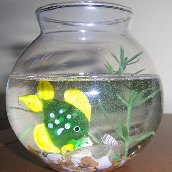 Green spotted glass fish in bowl