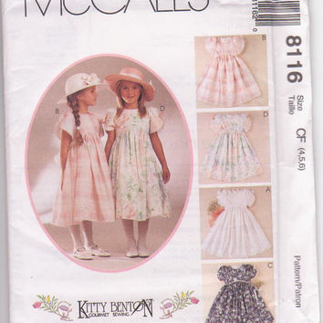 Kitty Benton designed pattern for empire waist party dress with short tulip sleeves girls size 4 5 6 McCalls 8116 UNCUT