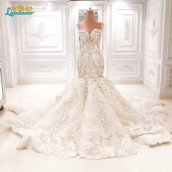 2016 Luxury Sparkly Backless mermaid wedding gowns with Appliques/Beads Cathedral Train Arabic mermaid Wedding Dresses Vestidos