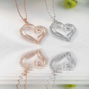 The beauty is obvious! Dual Heart Necklace in White or Rose Gold Triple Plating.