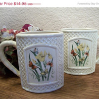 Coffee Mugs Set of Two Beige Butterflies and Flowers Ceramic Beverage Serving Cups Vintage Butterfly Garden Trellis Tableware by Enesco