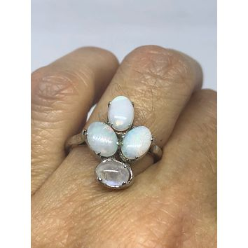 Vintage Handmade white Opal surrounded by Rainbow Moonstone Sterling Silver Rhodium Ring