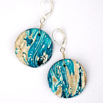Modern abstract painting like circular earrings. White and turquoise hippie style jewelry.