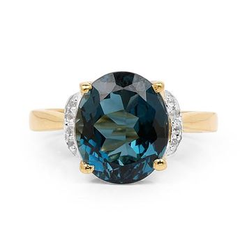 An Ethically Mined 14K Yellow Gold 6CT Oval Cut Genuine London Blue Topaz & White Diamond Ring