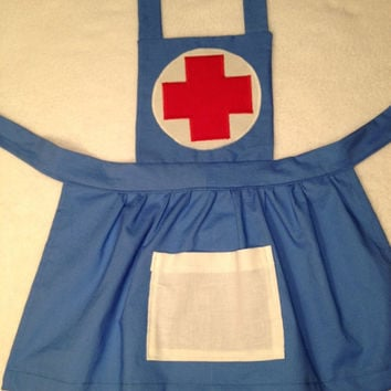 Girls nurse costume child nurse dress up nurse apron.  Perfect for pretend play.  Comes with felt bandaids for make believe wounded toys.