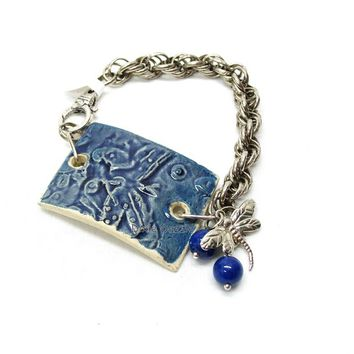 Handmade ceramic bracelet with lapis and dragonfly charms