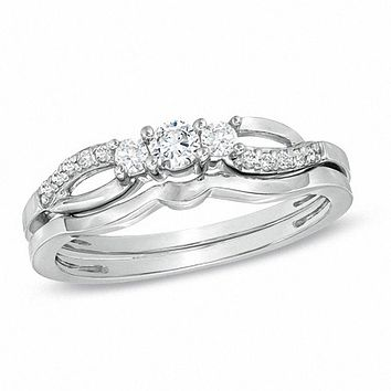 1/4 CT. T.W. Diamond Three Stone Split Shank Bridal Engagement Ring Set in Sterling Silver