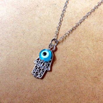 Hamsa hand with evil eye amulet necklace