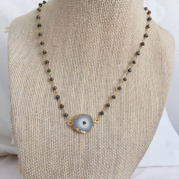 Silver pyrite beaded necklace with solar quartz connector pendant