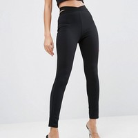 ASOS Textured Leggings with Elastic Cut Out at asos.com
