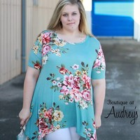 Plus Size Light Blue Short Sleeve Top with Floral Print and Asymmetrical Hem