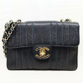 Vintage CHANEL black 2.55 jumbo caviar leather, large shoulder bag with golden CC. Vertical stitch. Classic caviarskin