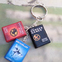 The Hunger Games trilogy book charm bracelet/keychain