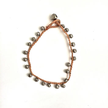 woven silver bell anklet in tan