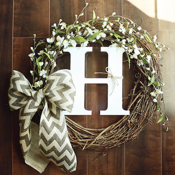 Monogrammed Grapevine Wreath with white flower details intertwined & a Chevron Burlap Bow