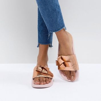 Ted Baker Melvah Rose Gold Leather Bow Slider at asos.com