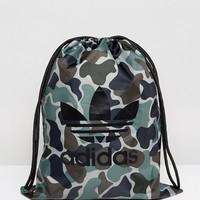 adidas Originals Gymsack In Camo at asos.com