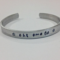 Chi Omega Cuff Bracelet - handstamped in a whimsical font on a non tarnish aluminum cuff, officially licensed
