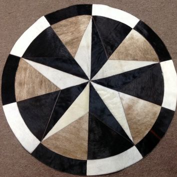SMALL01.  Round Hair on Cowhide Rug.