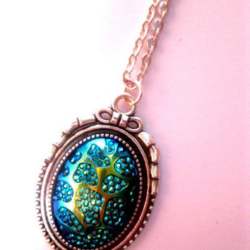 Metallic Blue Titanium Galaxy Necklace In Silver Bow Top Setting - Iridescent - Blue Green