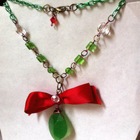 Red and green beaded necklace with red bow chalcedony pendant