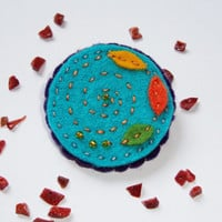 Felt brooch, teal, turquoise, with golden beads, seasons change