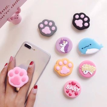 Soft silicone pop up stand and grip for cell phones or tablets