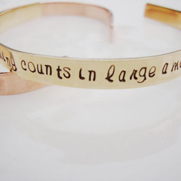 Everything counts in large amounts depeche mode inspired brass cuff