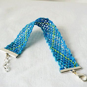 bracelet, handmade bobbin lace out of bead yarn, turquoise and yellow, silver fastener, laurinke no 1027